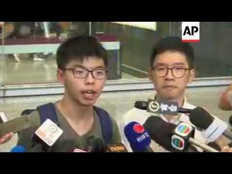 Activist Joshua Wong arrives back in Hong Kong