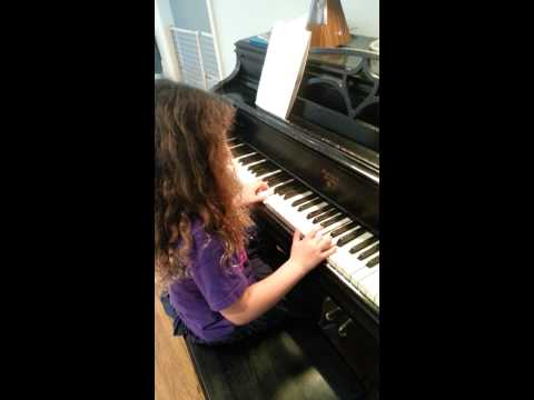 "Lailah (8) playing ""Waltzing Triads""  She struggles a bit, but one can't help it but admire her persistence."