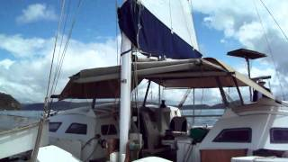 Tangaroa wharram catamaran. Motor sailing in the rain.