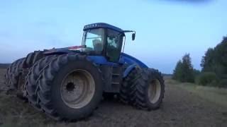 Дискование почвы на тракторе Нью Холланд