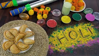 High angle shot of beautifully placed festive items for joyful Holi celebration in India