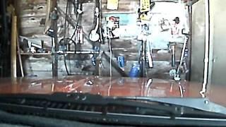 datsun skyline in a messy garage