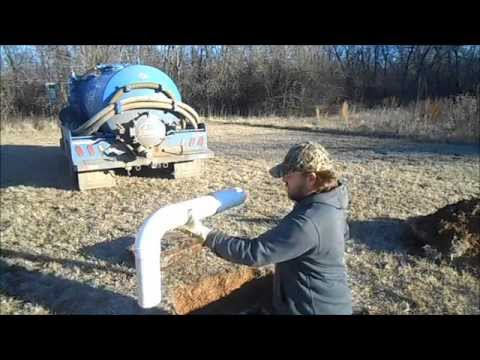 Installing an effluent outlet downturn baffle (filter) in a septic tank
