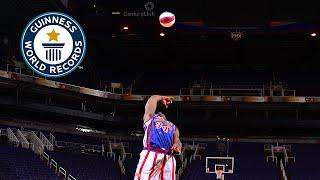Guinness World Records Day 2014 - Longest backwards basketball shot