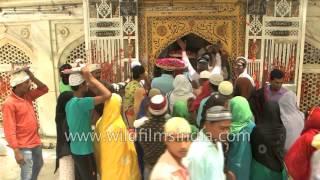 Pilgrims tie holy thread on Jannati Darwaza at Ajmer Sharif Dargah, Rajasthan