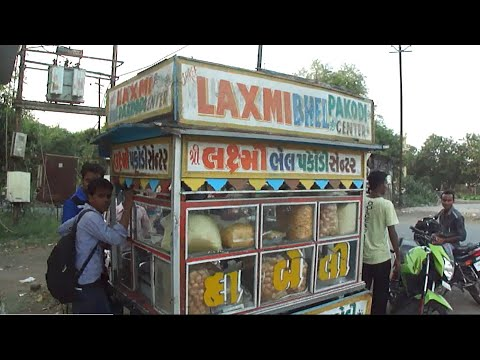 Ramesh Bhai at his Laxmi Bhel Pakodi Centre making Bhel, Pani Puri and Dhabeli - Indian Street Food