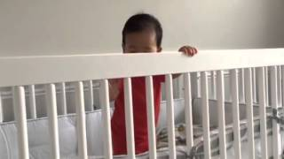 Grayson Standing Up In Crib