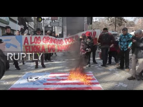 Chile: Protesters set fire to US flags upon Pence's visit to Santiago