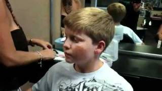 Adam gets his ears pierced