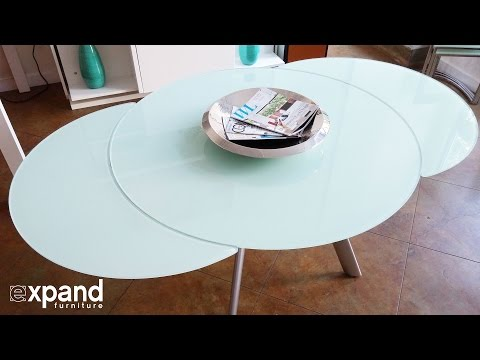 Butterfly Round Glass extending table demonstration
