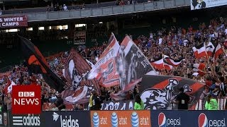Why do these US football fans chant in Spanish? - BBC News
