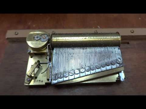Antique segmented comb music box
