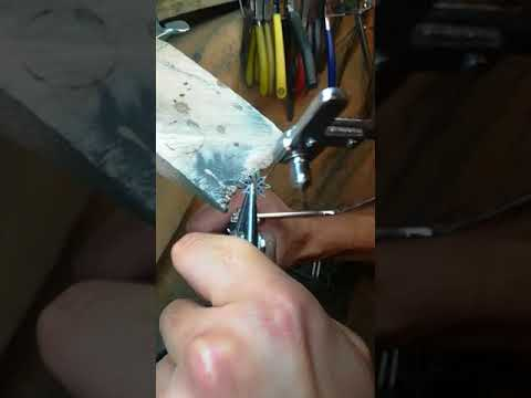 Hand Piercing the gallery for a bespoke engagement ring.