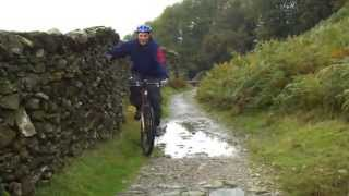 Great cycling stunt over ravine Thumbnail