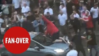 Football fan climbs on board MOVING car to celebrate England