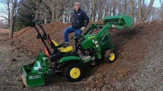 John Deere 1025R & my HUGE gravel drive way cut in. Phase 1