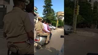 Jaipur Traffic Police not wear Helmet or 3 people seat 1 Scooty.