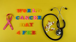 Top view of 'World Cancer Day 4 Feb' words composed with colorful plastic letters