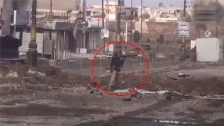 ISIS terrorist with the grenade launcher has been struck by sniper s shot Mosul,Iraq