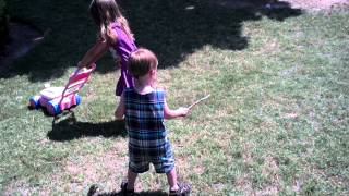 Eden and Liam Play with a Bubble Mower