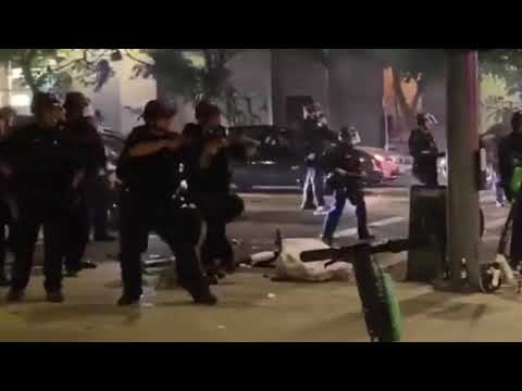 LA turned into a war zone after the Lakers game  - LAPD pushing back rioters with impact munition