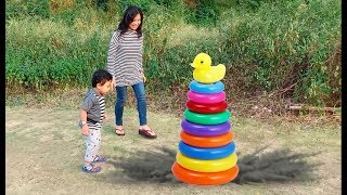 Reihan and Mom have fun playing with Stacking Rings