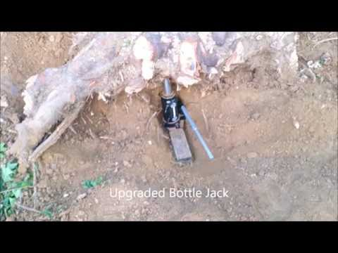 Stump removal by bottle jack and cutting the roots.