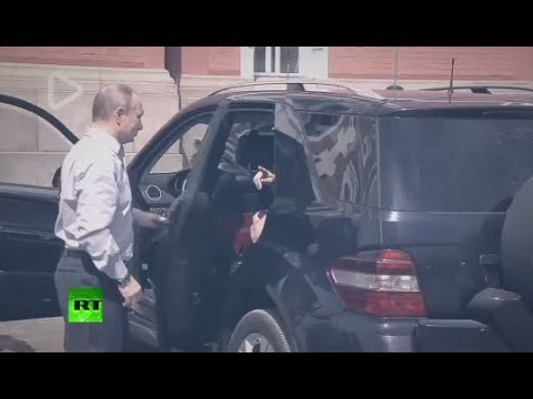 'Lady in red?' Putin's arrival at Russian monastery with 'mysterious passenger' causes media hype