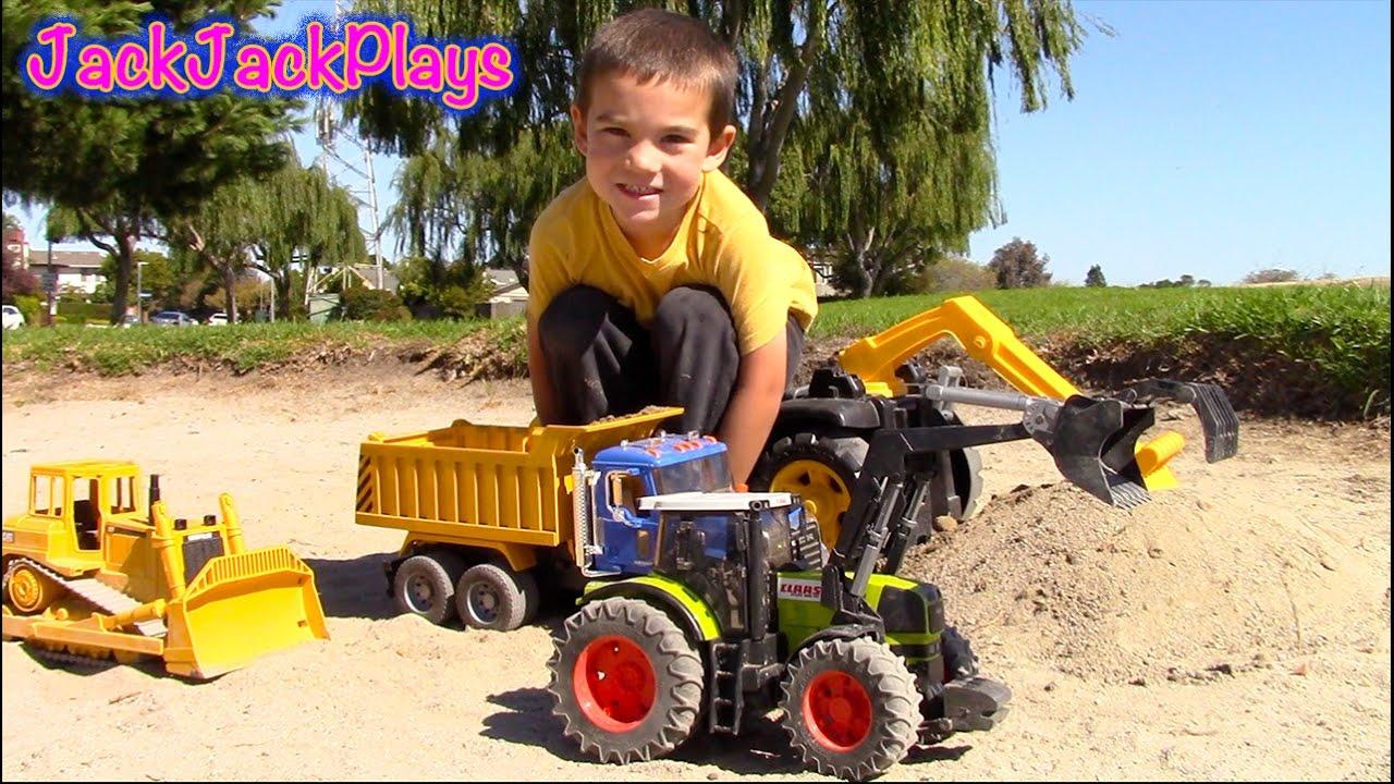 bruder toy trucks for children digging in the sand box bulldozer dump truck excavator. Black Bedroom Furniture Sets. Home Design Ideas