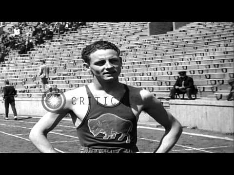 Glenn Cunningham wins the 1500 meter Kansas Relay in Lawrence, Kansas. HD Stock Footage