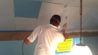 spraying ceiling tiles