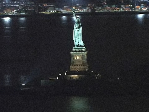 Raw: Statue of Liberty Lights Back On