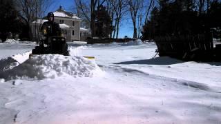 John deere 140 plowing heavy snow