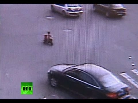 Image result for Child narrowly dodges death in busy traffic