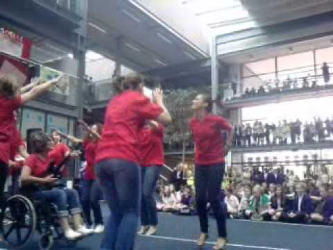 Bexley Buisness academy teachers performing Glee