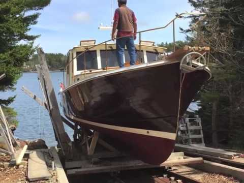 Launch of new 48-foot wooden boat by John's Bay Boat Co.
