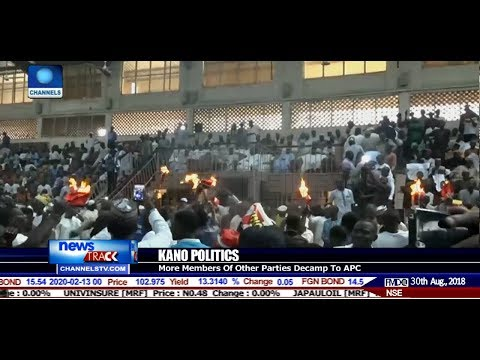 Tricyle Riders In Kano Set Red Caps On Fire To Symbolise Defection From PDP