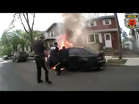 Cops Risk Their Lives to Pull Man From Burning Car