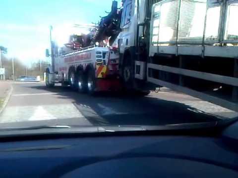 big rig truck pulls massive lorry