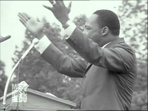 Martin Luther King Jr marches with people demonstrating for voting rights and oth...HD Stock Footage