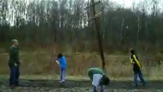 Me, Dad, Delaney, And Noah Throwing Rocks At A Telephone Pole At Wasser Bridge Road!