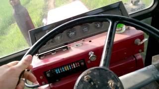 как трогаться с места на тракторе.