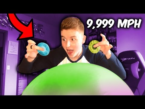 9,999 MPH FIDGET SPINNER VS GIANT WUBBLE BUBBLE BALL!