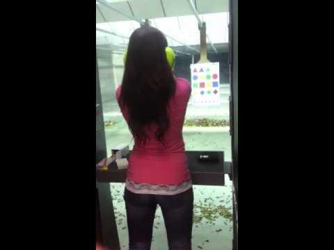 Girl shooting pistol