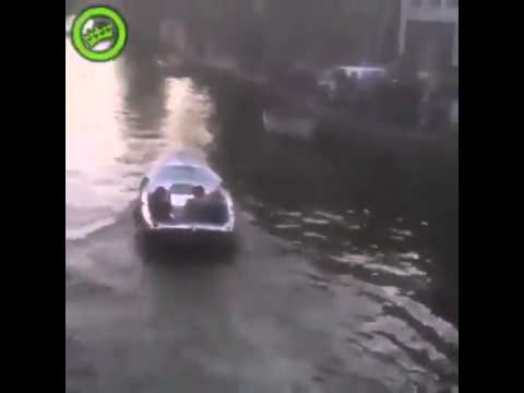 man jumps into amsterdam canal and lands in a boat