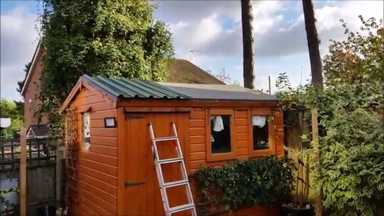 How to fit a metal panelled roof to a wooden shed - YouTube