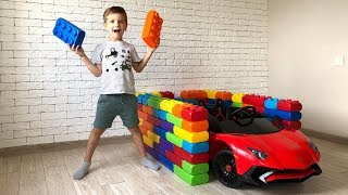Mark builds garages for Lamborghini cars from colored toy blocks.