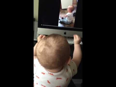 9-month-old rockin' out to a video of himself dancing
