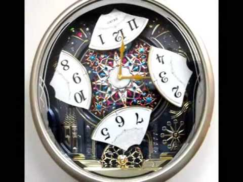 QXM239SRH - Seiko Melodies in Motion Carnival Celebration & Fireworks Animated Musical Clock