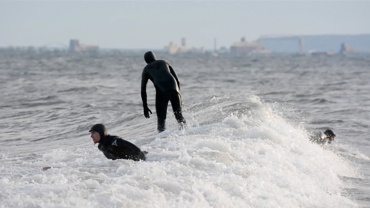 Surfers Catch A Wave On Lake Superior Off Brighton Beach In Duluth